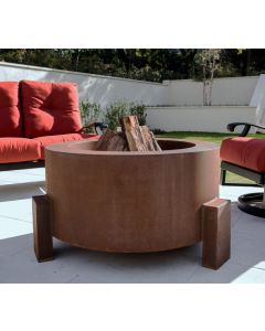 Weathered Cor-Ten steel wood burning fire pit with natural wood in the fire bowl.