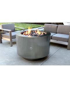 Stainless steel gas fire pit with large fire rock in the fire bowl.  Flames are emitting from the fire stones.