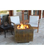 11 GA Cor-Ten Steel Hidden Tank fire pit in the weather condition with flames in fire bowl.