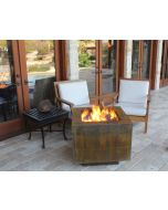 38 inch square Cor-Ten steel hidden tank fire pit on a pave stone patio.