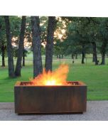 Rectangular Cor-Ten Steel hidden tank fire pit with large flames in the fire bowl.